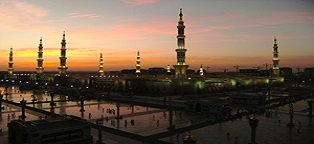 An Islamic Mosque (in Medina, Saudi Arabia) at night.  Mosque is called Masjid An-Nabawi(Mosque of the Prophet)