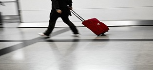 business person walking in airport