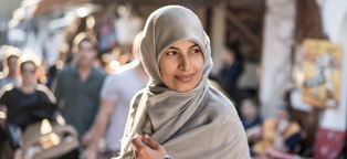 muslim woman with head scarf in outdoor market